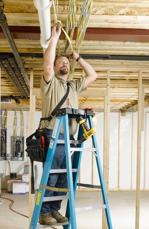 Electrician using Werner FS108 Step Ladder