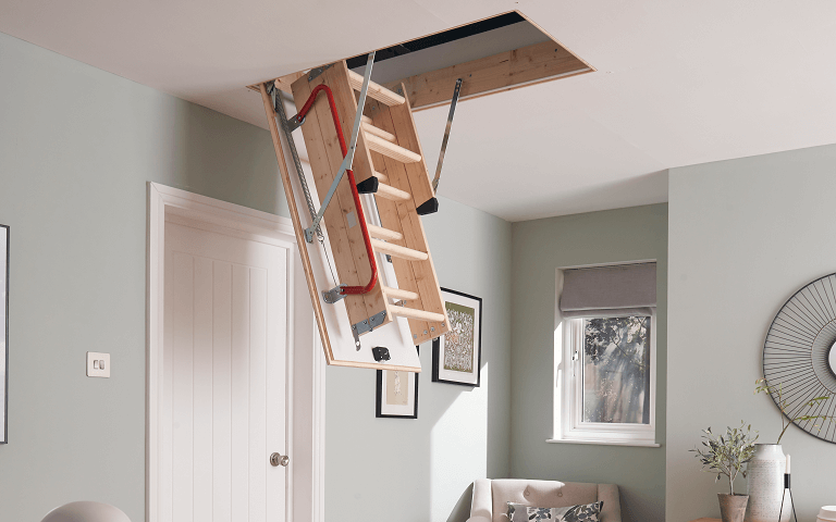 Werner UK loft ladders with a space-saving design stored in loft hatch